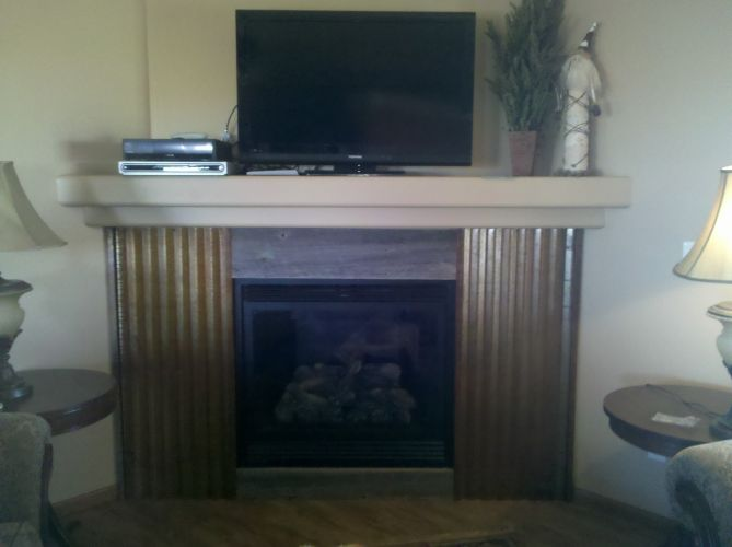 Built-In Gas Fireplace With Tin Surround
